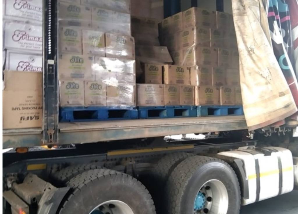 Four people were arrested and an assortment of suspected stolen groceries valued at around R100 000 recovered inside the shop and in a truck trailer.