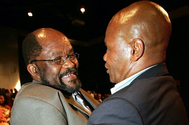 Leonard Chuene (R) congratulates Mluleki George (L) after George received the Steve Tshwete Lifetime Achievement Award (2005).