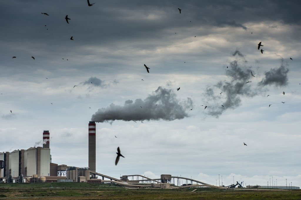 Emissions rise from a tower of the Eskom Holdings
