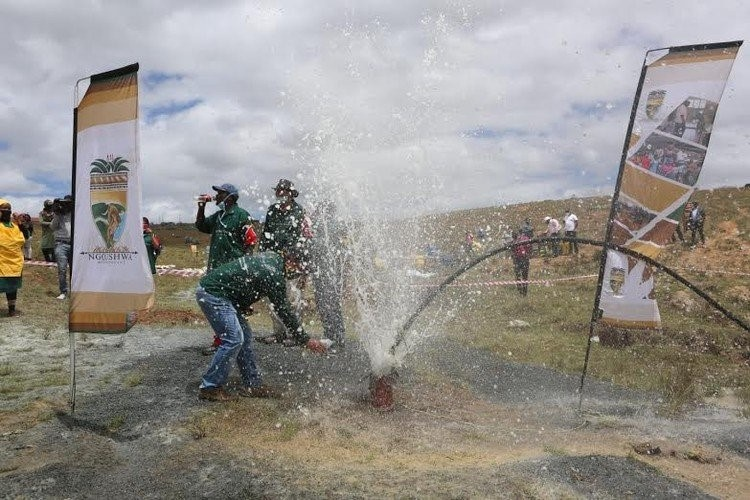 Water gushes from a new borehole in Feni Village in Ngqushwa. Photo: Johnnie Isaac/GroundUp