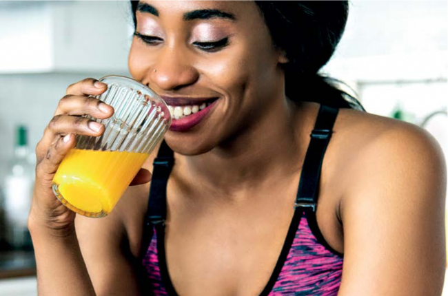 Woman sipping on orange juice. Image: Gallo/Getty Images