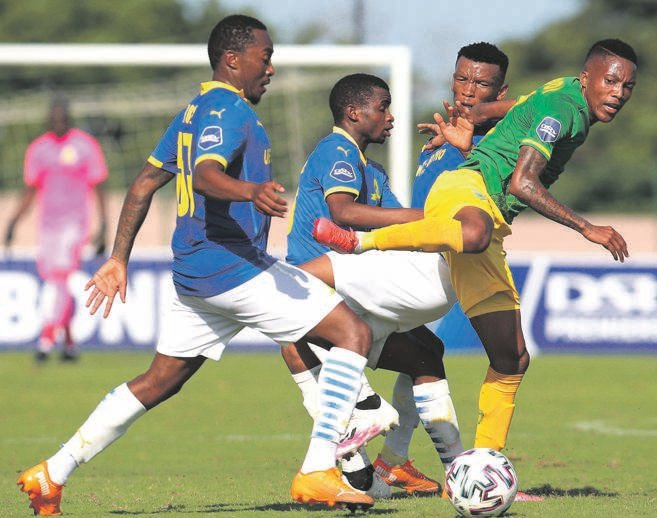 roadblock Pule Mmodi of Golden Arrows is challenged by Mamelodi Sundowns trio of Lebohang Maboe, Promise Mkhuma and Mothobi Mvala during their DStv Premiership game in Durban yesterdayPHOTO: BackPagePix / Gallo Images