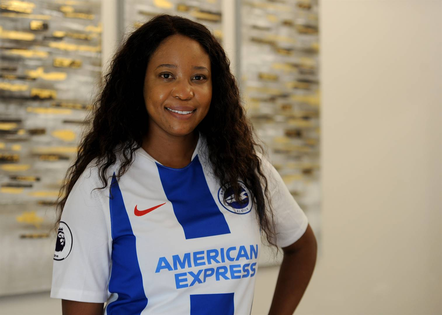 Percy Tau's agent Mmatsatsi Sefalafala sporting the Brighton jersey during her interview with City Press this week. Picture: TEBOGO LETSIE