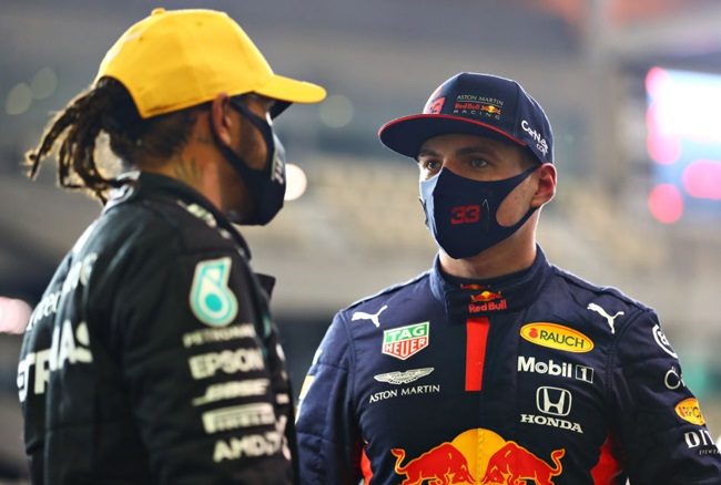 Pole position qualifier Max Verstappen of Netherlands and Red Bull Racing speaks with third placed qualifier Lewis Hamilton of Great Britain and Mercedes GP in parc ferme during qualifying ahead of the F1 Grand Prix of Abu Dhabi at Yas Marina Circuit on December 12, 2020 in Abu Dhabi, United Arab Emirates.