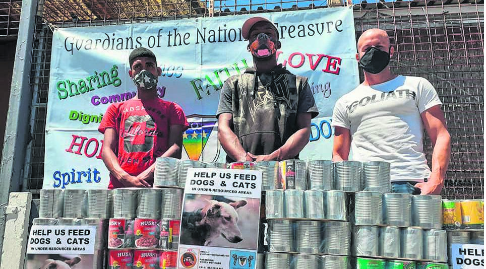 Youth Pet Care and Guardians of the National Treasure collect food donations for dogs in under-resourced areas. PHOTO: Youth Pet Care   Facebook