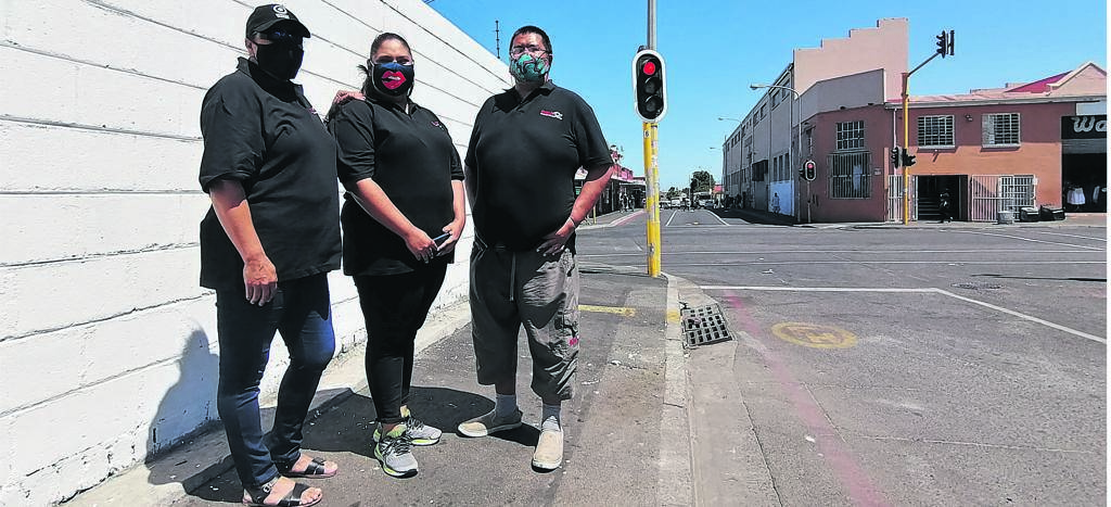 Wynberg East Neighbourhood Watch members Salwa Beukes, Nadia Hassen and Shamil Hendricks stand on Broad Close. Until recently, the pavement was covered in with temporary shelters. PHOTO: Nettalie Viljoen