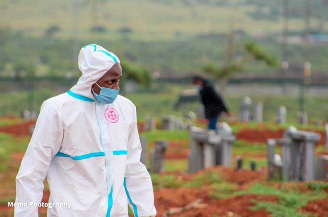 A worker from Uitenhage Funeral Home carrying out his duties during a funeral in the Eastern Cape
