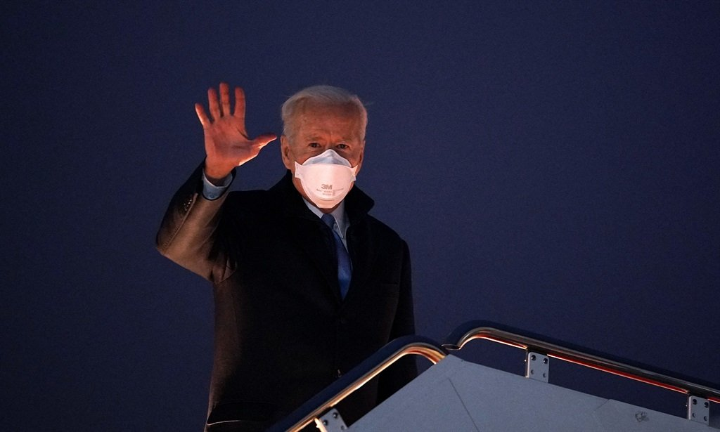 US President Joe Biden waves as he boards Air Force One before departing from Andrews Air Force Base in Maryland on 12 February 2021.