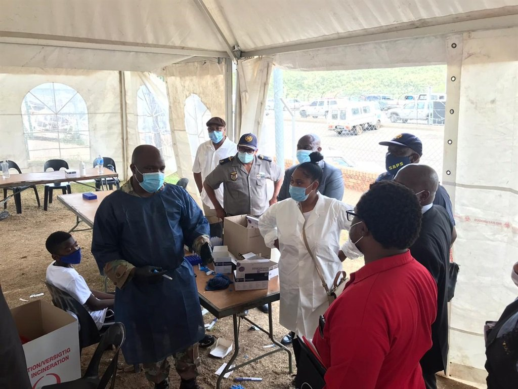 Home Affairs Portfolio Committee members speak to health care workers testing people at the Lebombo border post.