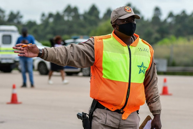 Police monitor adherence to the level 4 lockdown regulations at Marianhill Toll Plaza on May 04, 2020 in Durban, South Africa.