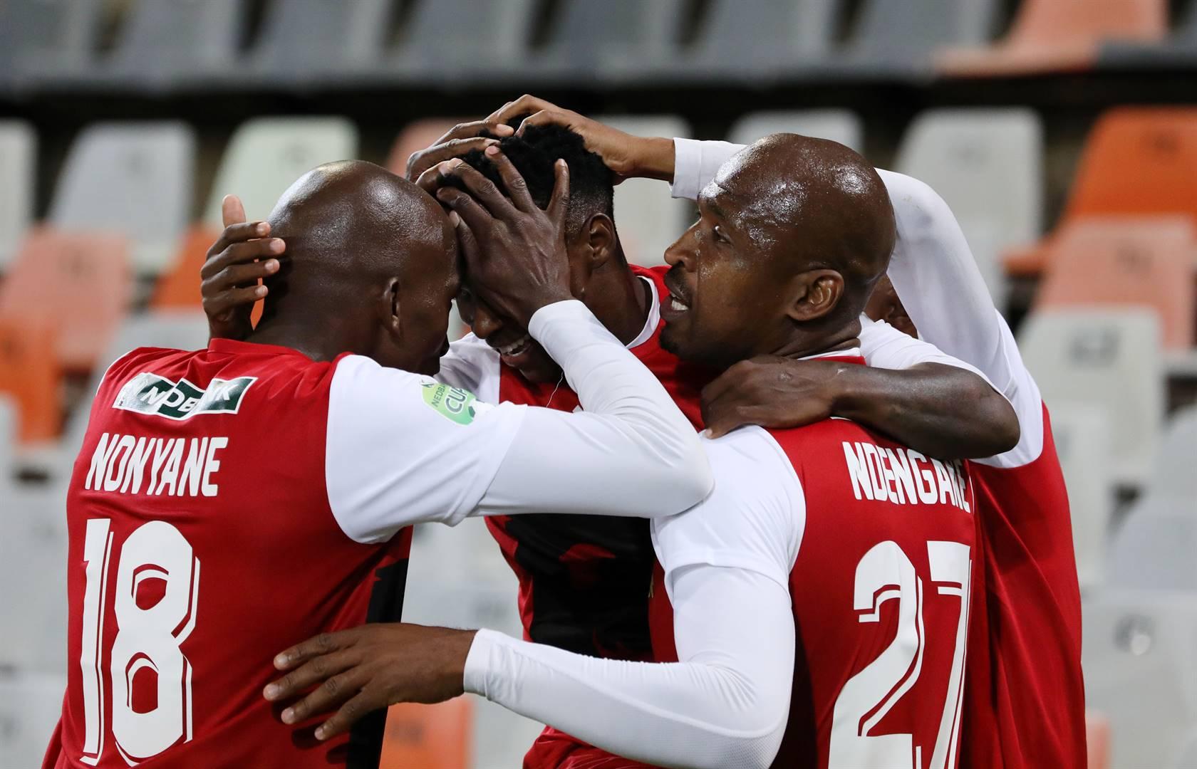 Tshakhuma players embrace Ndabayithethwa Ndlondlo, who scored against Chippa United in the Nedbank Cup final at Free State Stadium in Bloemfontein on Saturday. Photo: Muzi Ntombela / BackpagePix