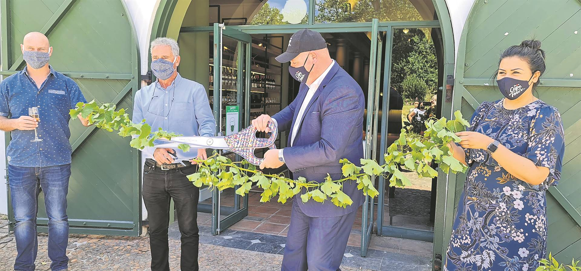 Floricius Beukes, manager and viticulturist for Groot Constantia; Jean Naudé, CEO Groot Constantia; James Vos, Mayco member for economic opportunities and asset management; and Lila Jutzen, sales and marketing Groot Constantia; at the opening of the gift shop.