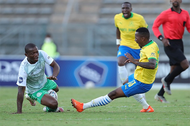 Lebohang Maboe of Mamelodi Sundowns challenged by Lantshene Phalane of Bloemfontein Celtic during the DStv Premiership match between Mamelodi Sundowns and Bloemfontein Celtic at Lucas Masterpieces Moripe Stadium on January 19, 2021 in Pretoria, South Africa.