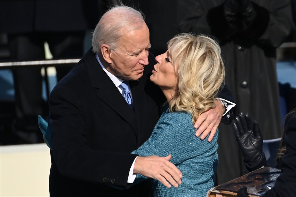 US President Joe Biden  kisses US First Lady Jill Biden after being sworn in as the 46th US President, on January 20, 2021, at the US Capitol in Washington, DC. Biden was sworn in as the 46th president of the US. (SAUL LOEB / POOL / AFP)