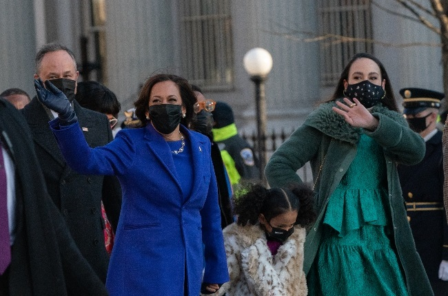 US Vice-President Kamala Harris waves while walking with her family during the 46th presidential inauguration parade. (Photo: Gallo Images/Getty Images)