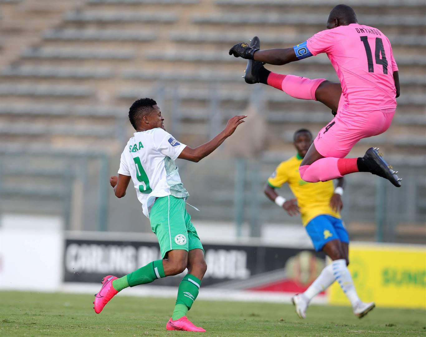 Bloemfontein Celtic striker Motebang Sera, seen here being challenged by Mamelodi Sundowns goalkeeper Denis Onyango, had his goal disallowed in this game on Tuesday. Picture: Samuel Shivambu / BackpagePix