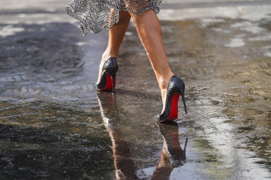PARIS, FRANCE - MARCH 03: Black and red Louboutin