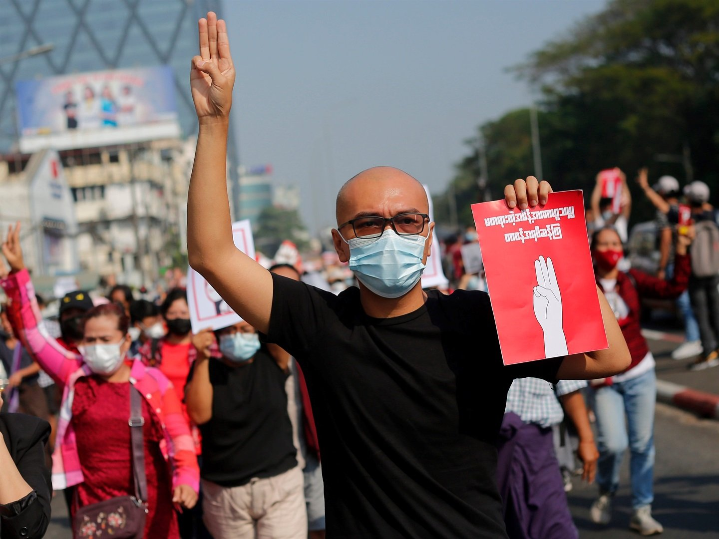 A Myanmar protester makes the three finger salute during a demonstration against military coup in Yangon Myanmar