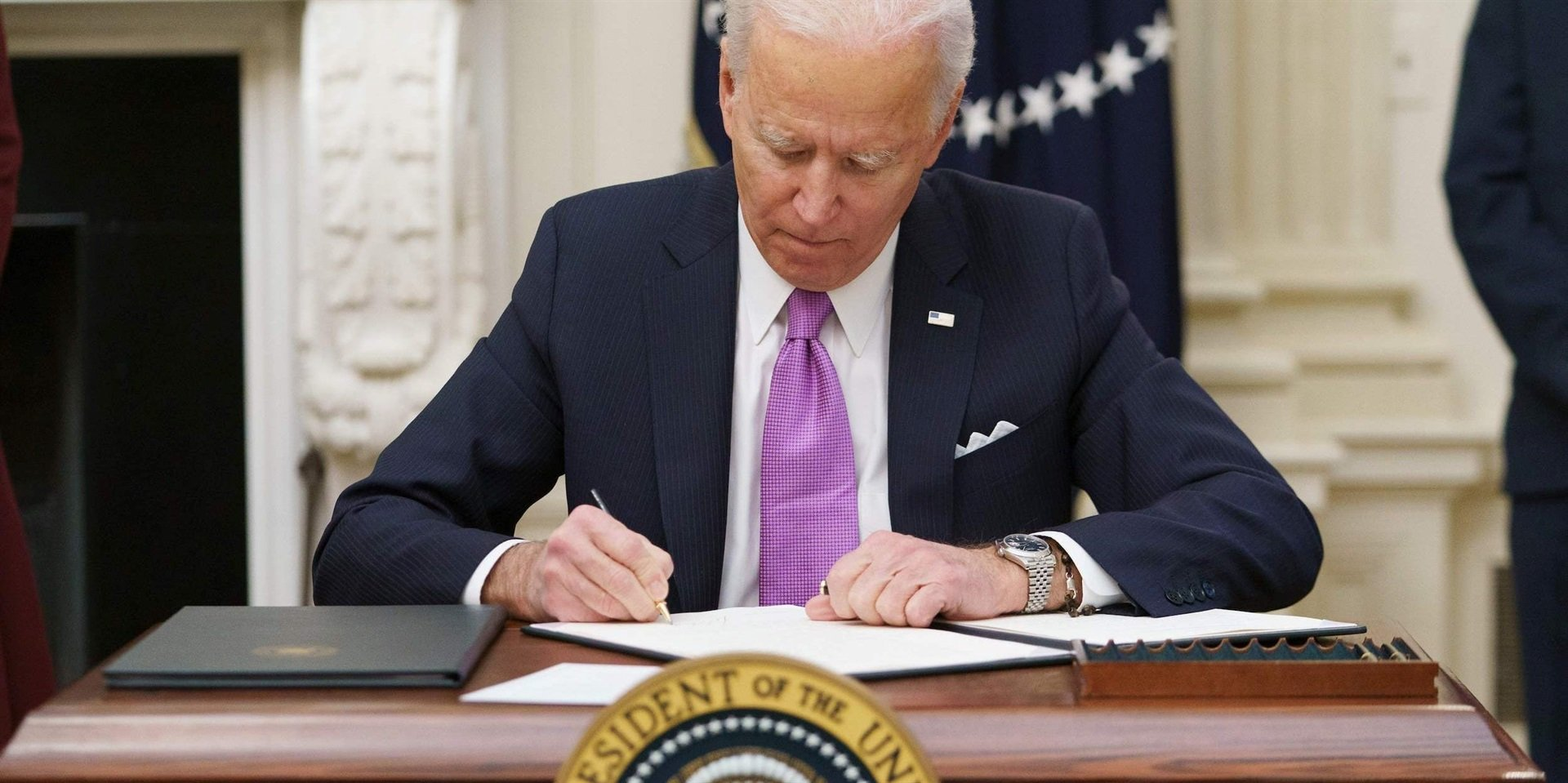 President Joe Biden signs executive orders in the first days of his presidency.