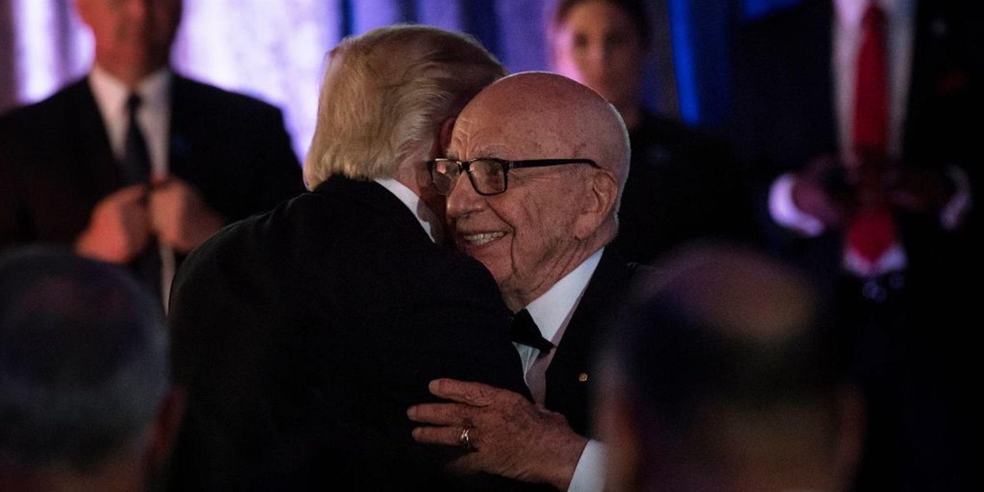 Former US President Donald Trump is embraced by Rupert Murdoch