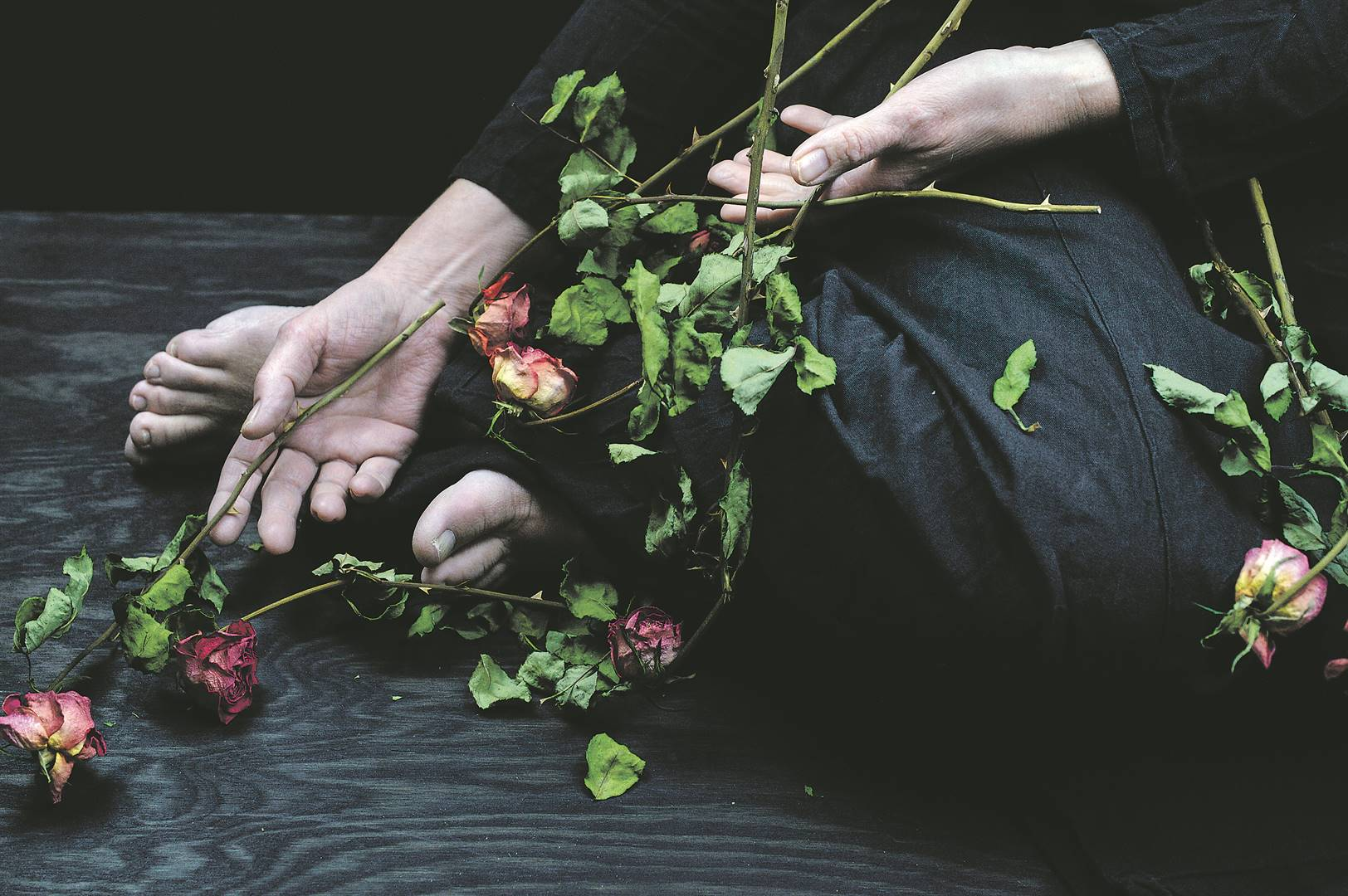 In some cultures, dead roses and women dressed in black are symbols of mourning for widows. Men are not subjected to similar mourning rituals. Picture: iStock
