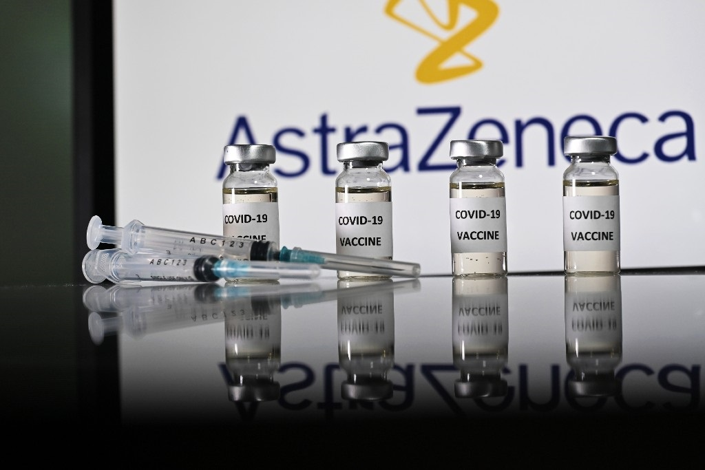An illustration picture shows vials with Covid-19 vaccine stickers attached and syringes with the logo of AstraZeneca.