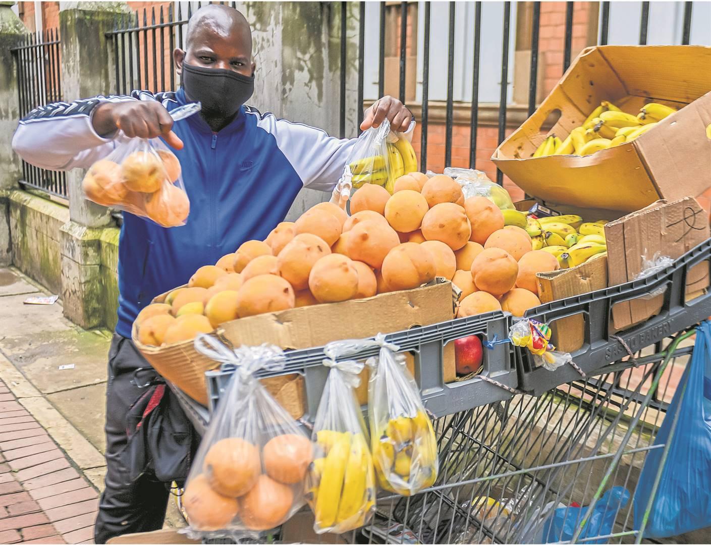 Ishmael Razack selling his wares in the CBD of Pietermaritzburg.