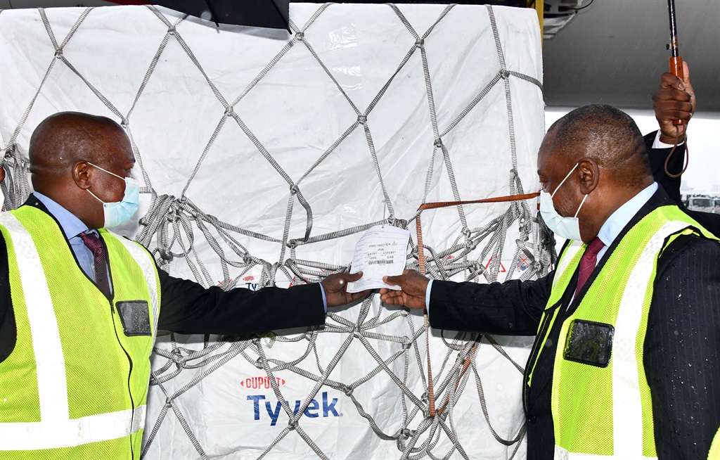 President Cyril Ramaphosa and Deputy President David Mabuza receive South Africa's first consignment of the Covid-19 coronavirus vaccine from the Serum Institute of India at OR Tambo International Airport in Johannesburg earlier in February.