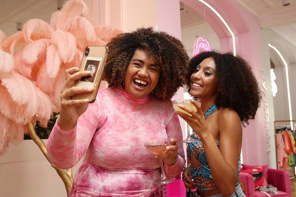 Models Asinate Yaranamua and Armani Pinto take a selfie at a boohoo Black Friday gifting suite in Sydney, Australia. (Photo by Don Arnold/WireImage)