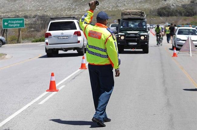Traffic officer at a road block.