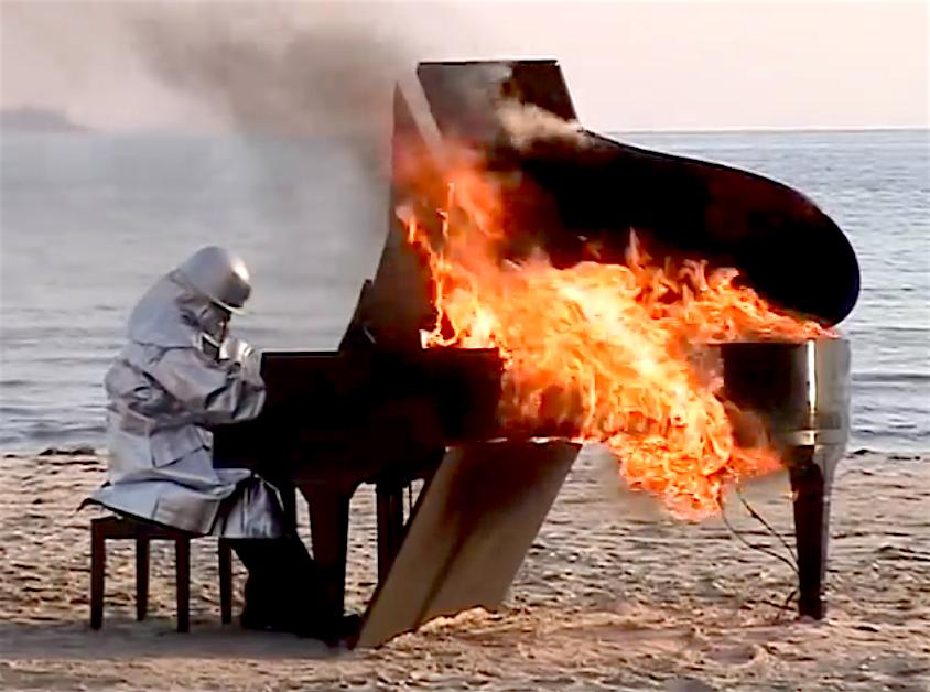 A still from the 2008 performance 'Burning Piano' by legendary Japanese Jazz pianist, Yosuke Yamashita. (Photo: Still from Burning Piano)