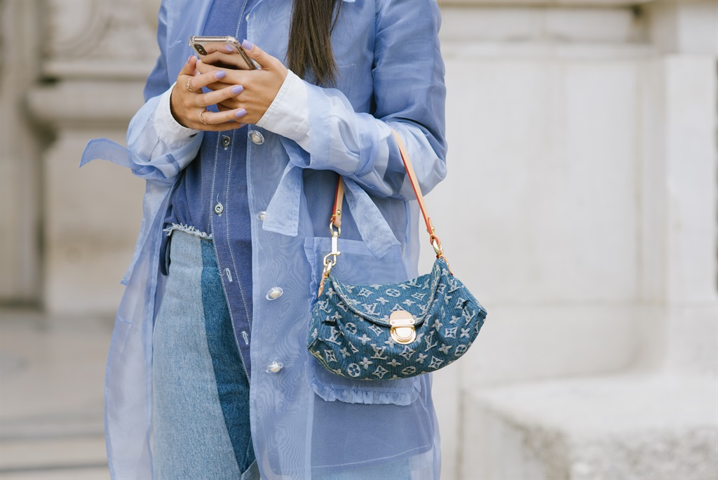 A guest poses with a Louis Vuitton bag after the Acne Studios show at the Grand Palais during Paris Fashion Week - Womenswear Spring summer 2021 on September 30, 2020 in Paris, France. Photo by Vanni Bassetti/Getty Images