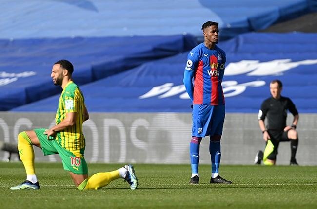 Wilfried Zaha of Crystal Palace stands at kick off