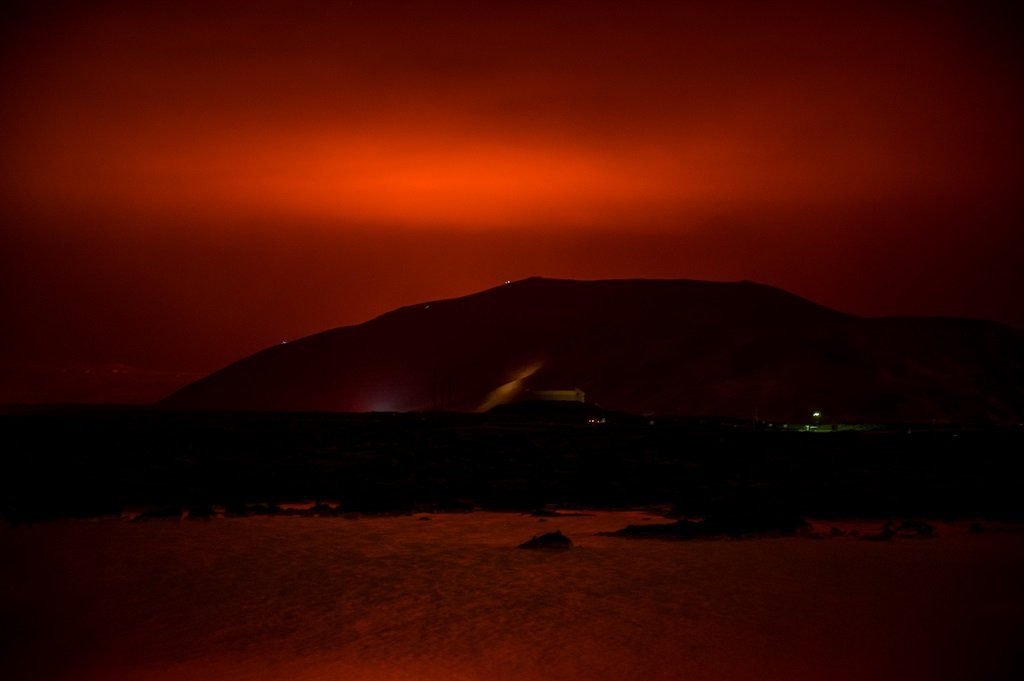 The red shimmer from magma flowing out from the er
