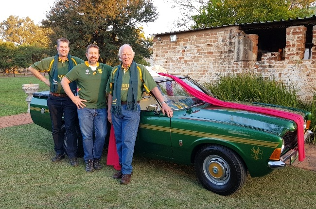 Brian Rademeyer (middle) with Johan and Gustav Nel, who restored Brian's Cortina Springbok. (Photo: Supplied)