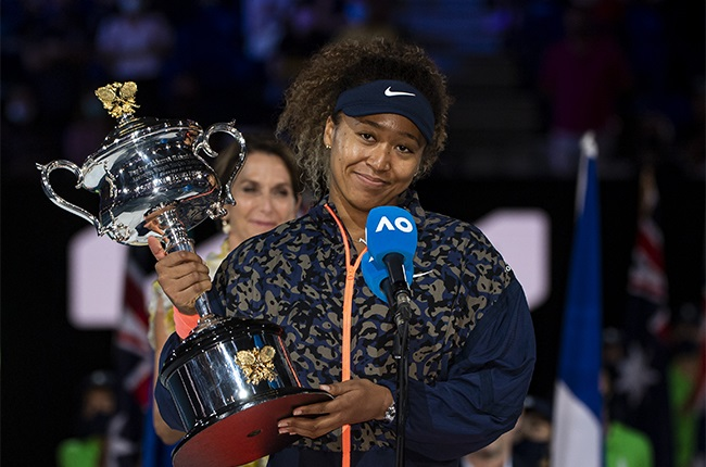 Naomi Osaka of Japan celebrates with the Trophy after defeating Jennifer Brady of the United States in the womens singles final.