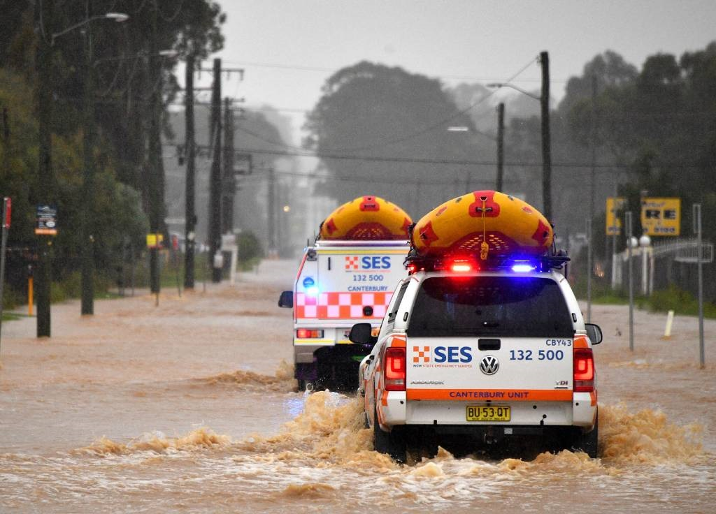 State Emergency Service vehicles approach flooded