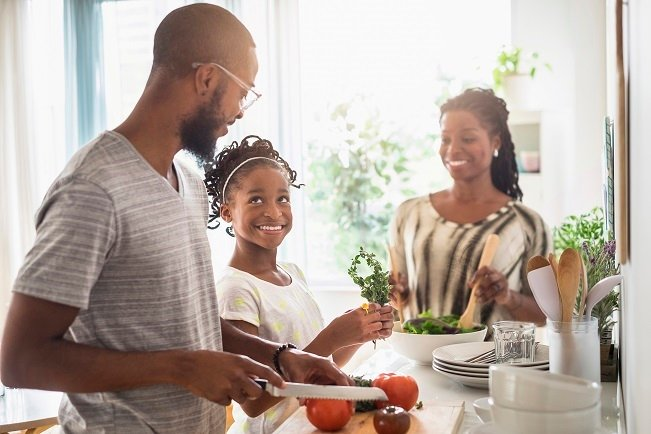Happy family cooking dinner.