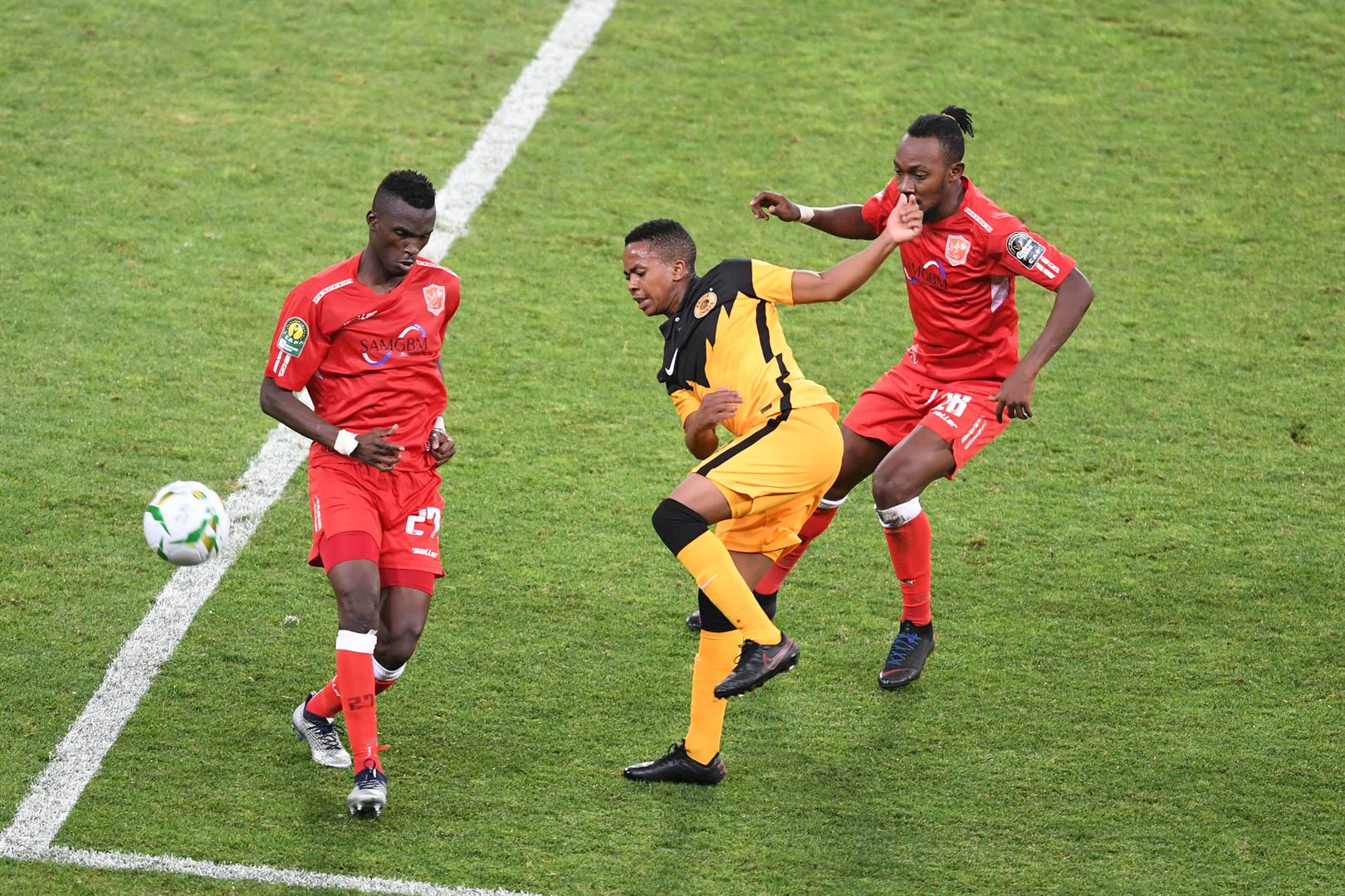 Kaizer Chiefs' Nkosingiphile Ngcobo shoots under pressure from Abou Mangue Camara of Horoya AC during their CAF Champions League group match at FNB Stadium on Tuesday night. Picture: Lefty Shivambu / Gallo Images