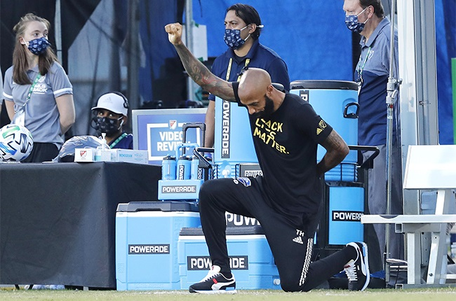 Head coach Thierry Henry of Montreal Impact takes a knee in support of the Black Lives Matter movement. (Photo by Michael Reaves/Getty Images)