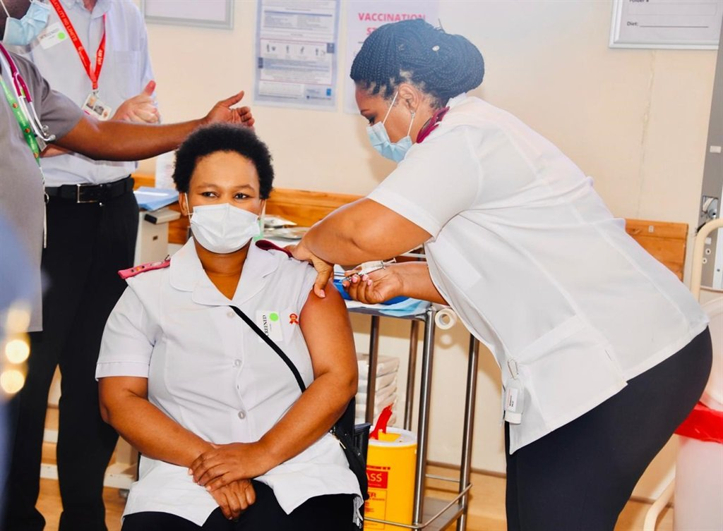 Nurse Zoliswa Gidi-Dyosi was the first to receive a Covid-19 vaccine at Khayelitsha District Hospital in Cape Town.
