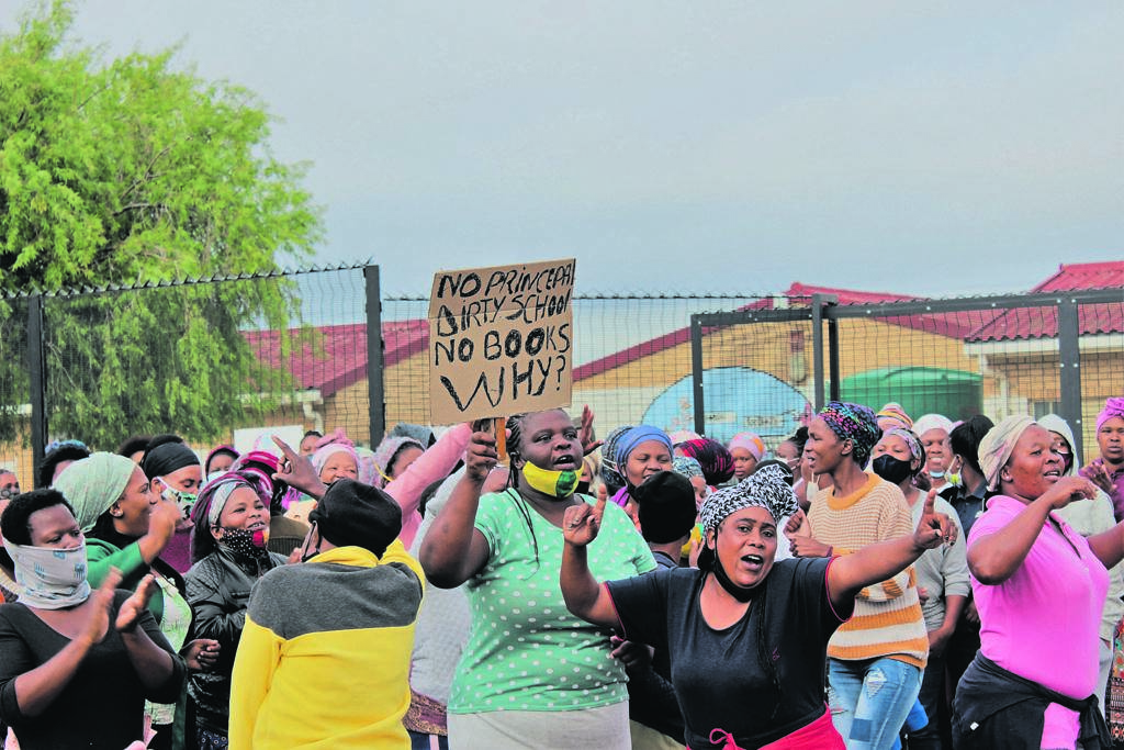 Parents at high voices made their presence felt outside the school on Thursday and Friday morning.PHOTO:
