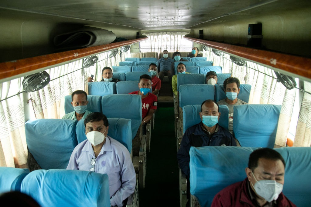 Passengers wear face masks and maintain social distancing after the public transport restrictions lift as a preventive measure against the spread of Coronavirus.