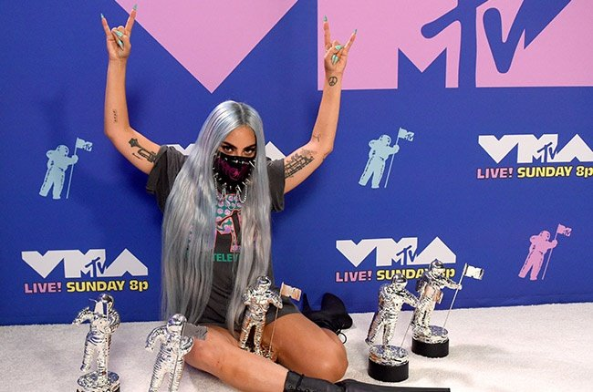 Lady Gaga poses with her awards during the 2020 MTV Video Music Awards.