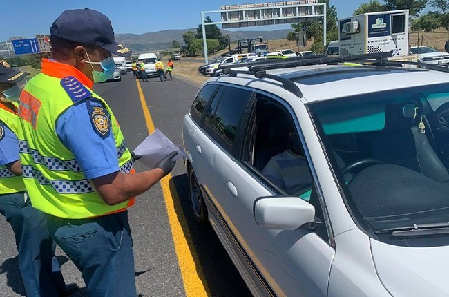 Traffic officer at a roadblock
