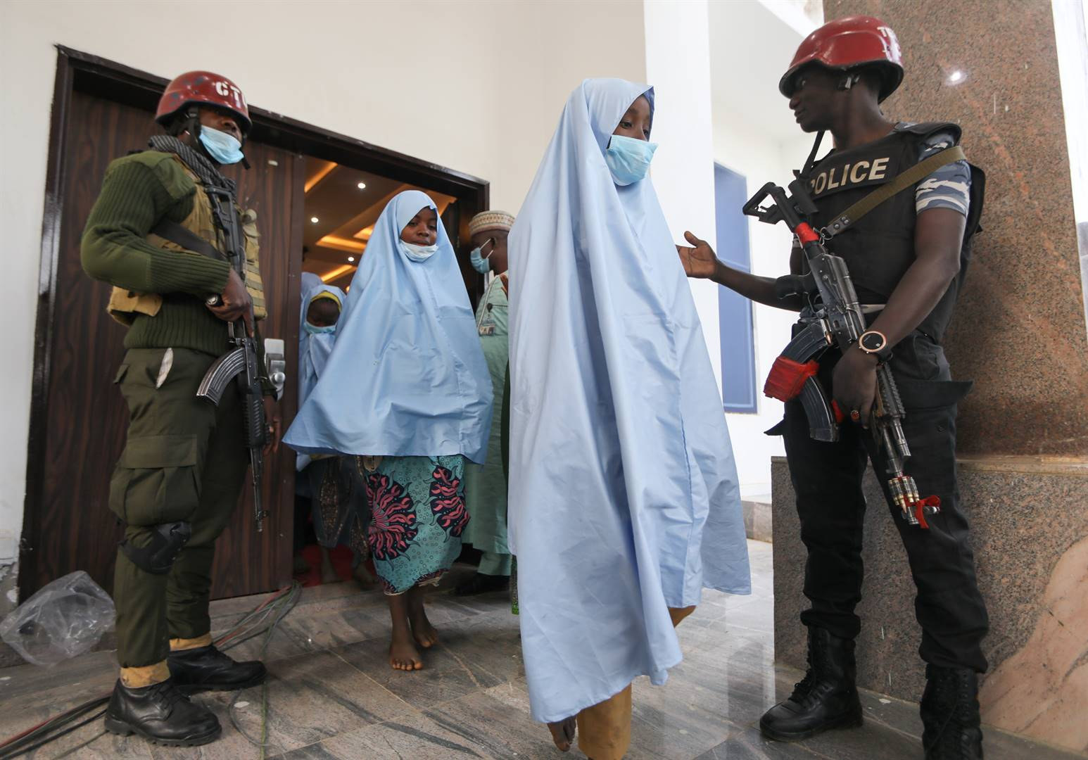 Girls who were kidnapped from a boarding school in the northwest Nigerian state of Zamfara, head for a medical check-up after their release. Picture: Reuters