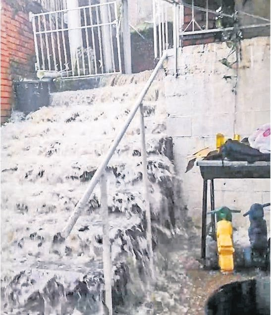 A screenshot taken from the video of flooding at the Maharaj family's home in Allandale.
