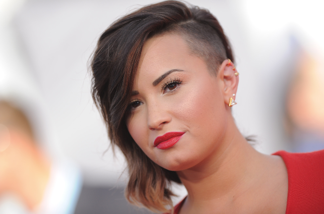 Actress/singer Demi Lovato arrives at the 2014 MTV Video Music Awards. Photographed by Axelle/Bauer-Griffin