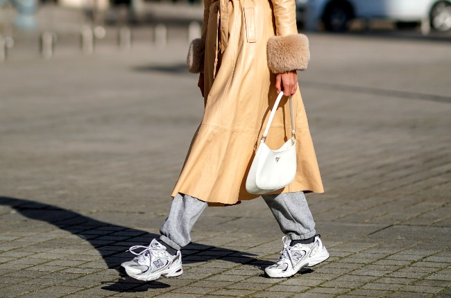 Takkies and a high-end coat for your weekend commitments? (Photo by Edward Berthelot/Getty Images)