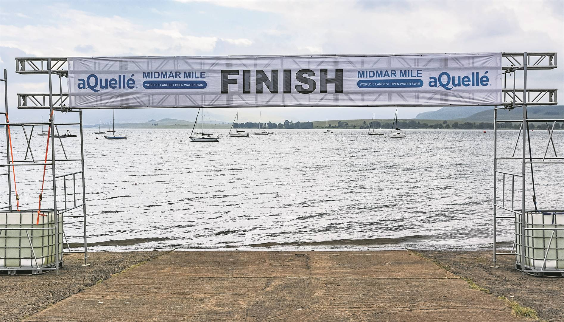 Instead of thousands of excited swimmers of all ages from far and wide flocking to Howick over one weekend, this year's Midmar Mile features an elite race, a virtual race and a charity swim.